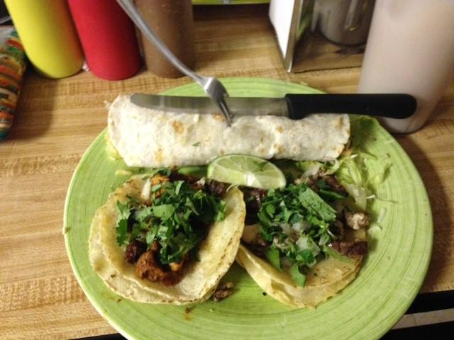 Burrito de asada chico and tacos de cesos y pastor with a glass of horchata.