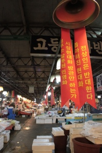 Bell Protest banners at market